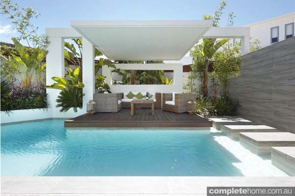 Escape the hustle and bustle of the outside world and step into this calming tropical suburban haven to relax and unwind
