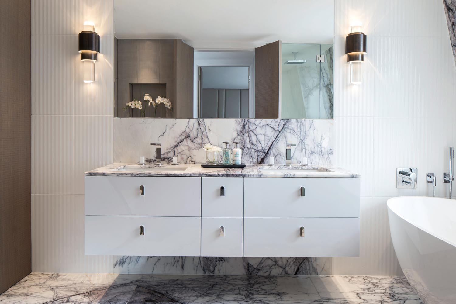 Black-veined white marble is a luxe and textural material ideal for a classic bathroom