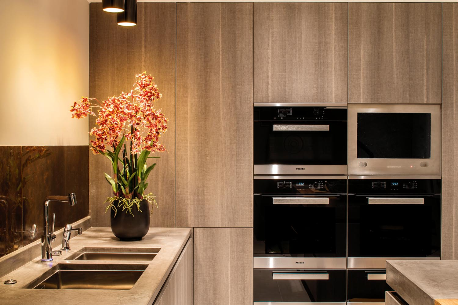 A chef's dream, the kitchen  features an array of appliances including a double oven and steamer
