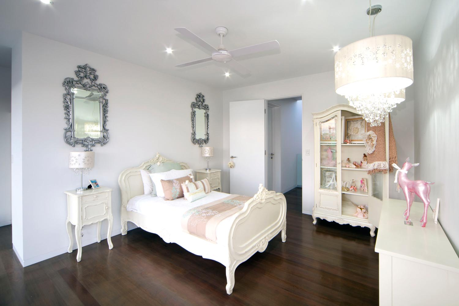 Hints of baby pink and creamy white make this bedroom pure elegance