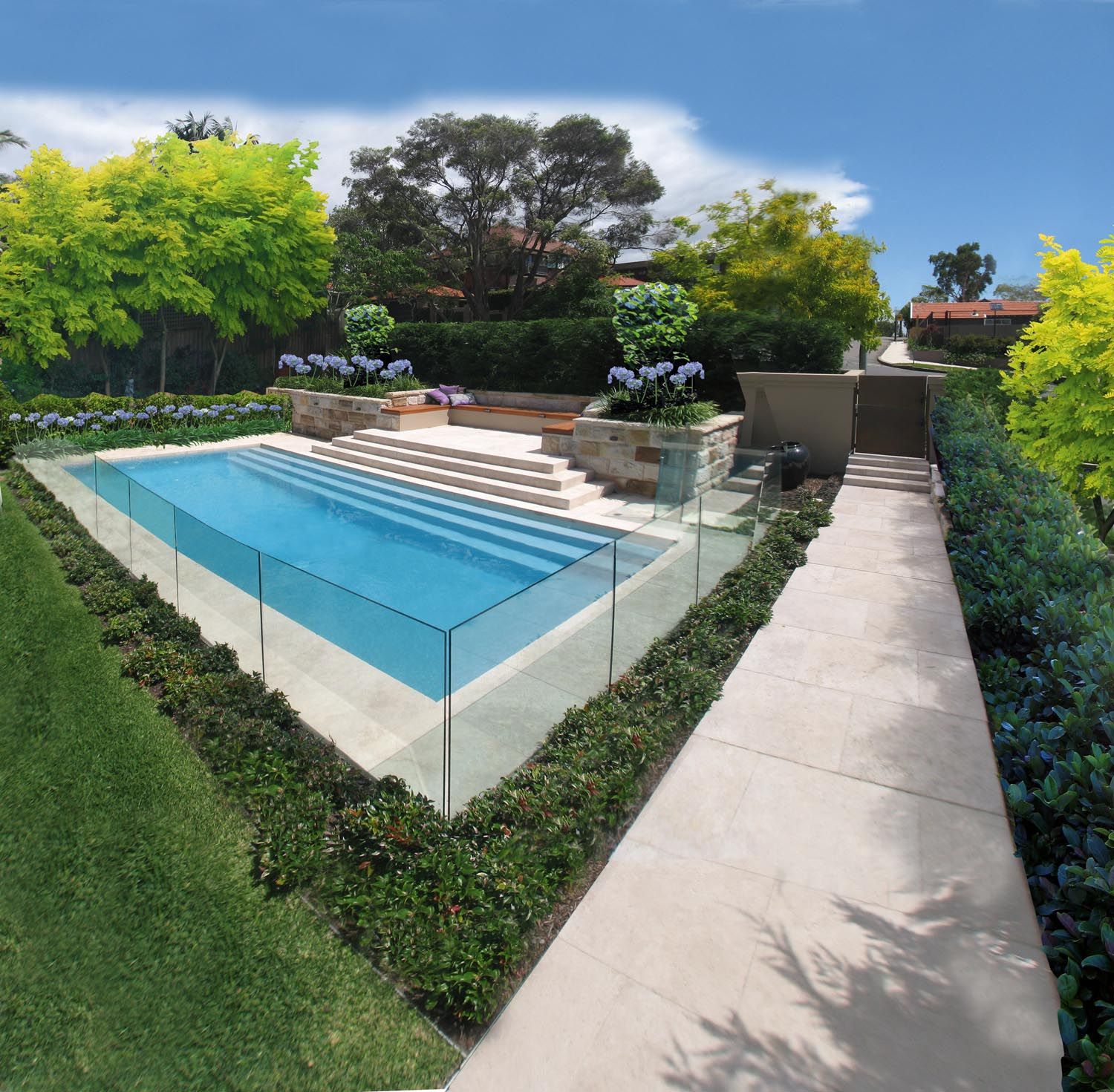 Corner view of a modern pool surrounded by a glass wall in the garden