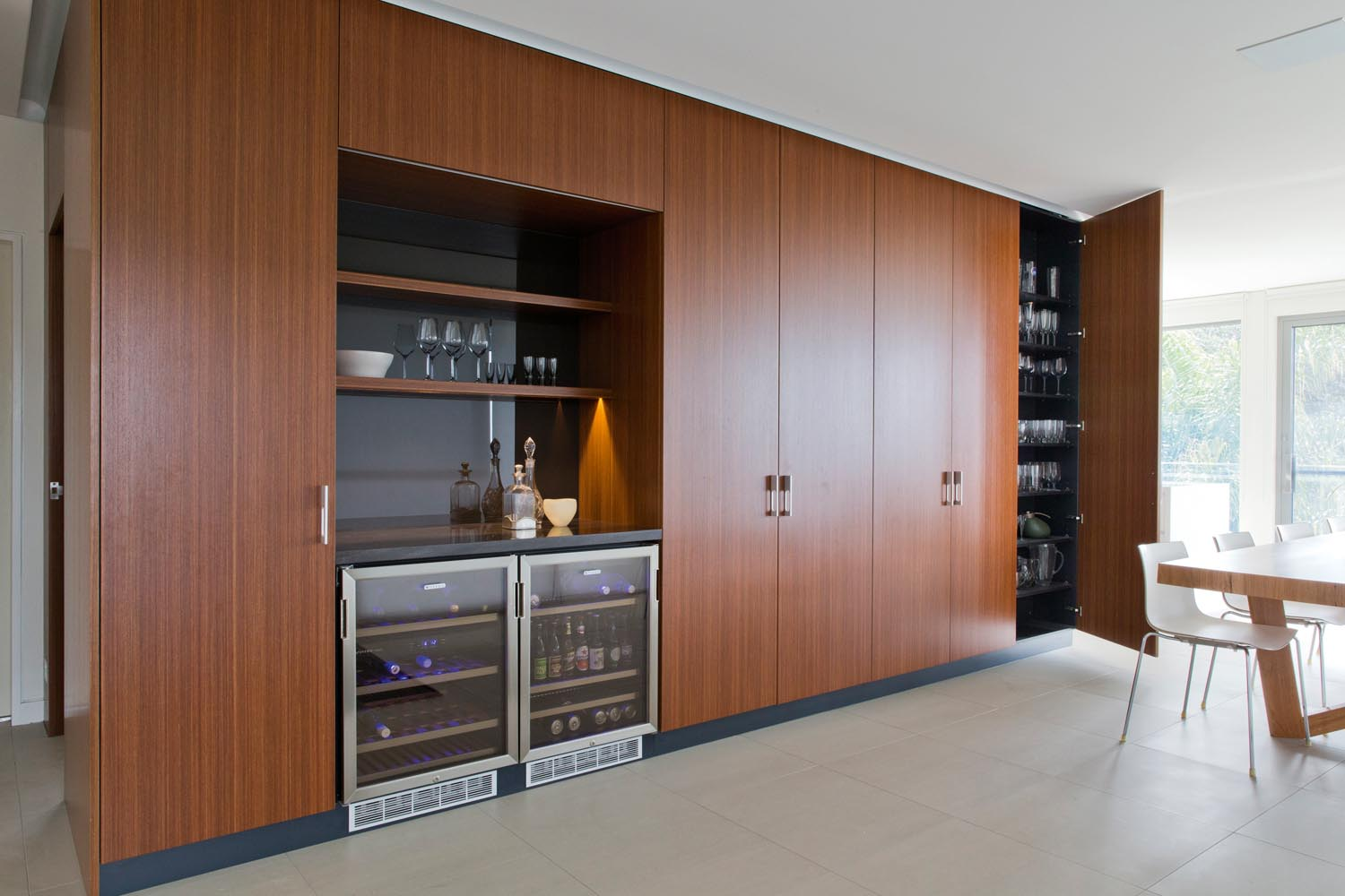 A minibar and a big cupboard for glassware