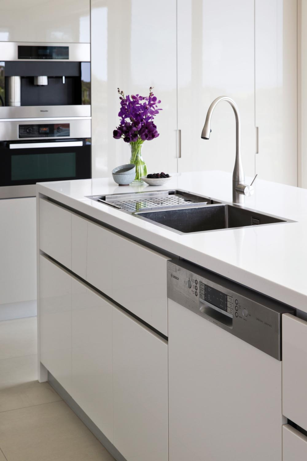 A white modern sink with bright flowers