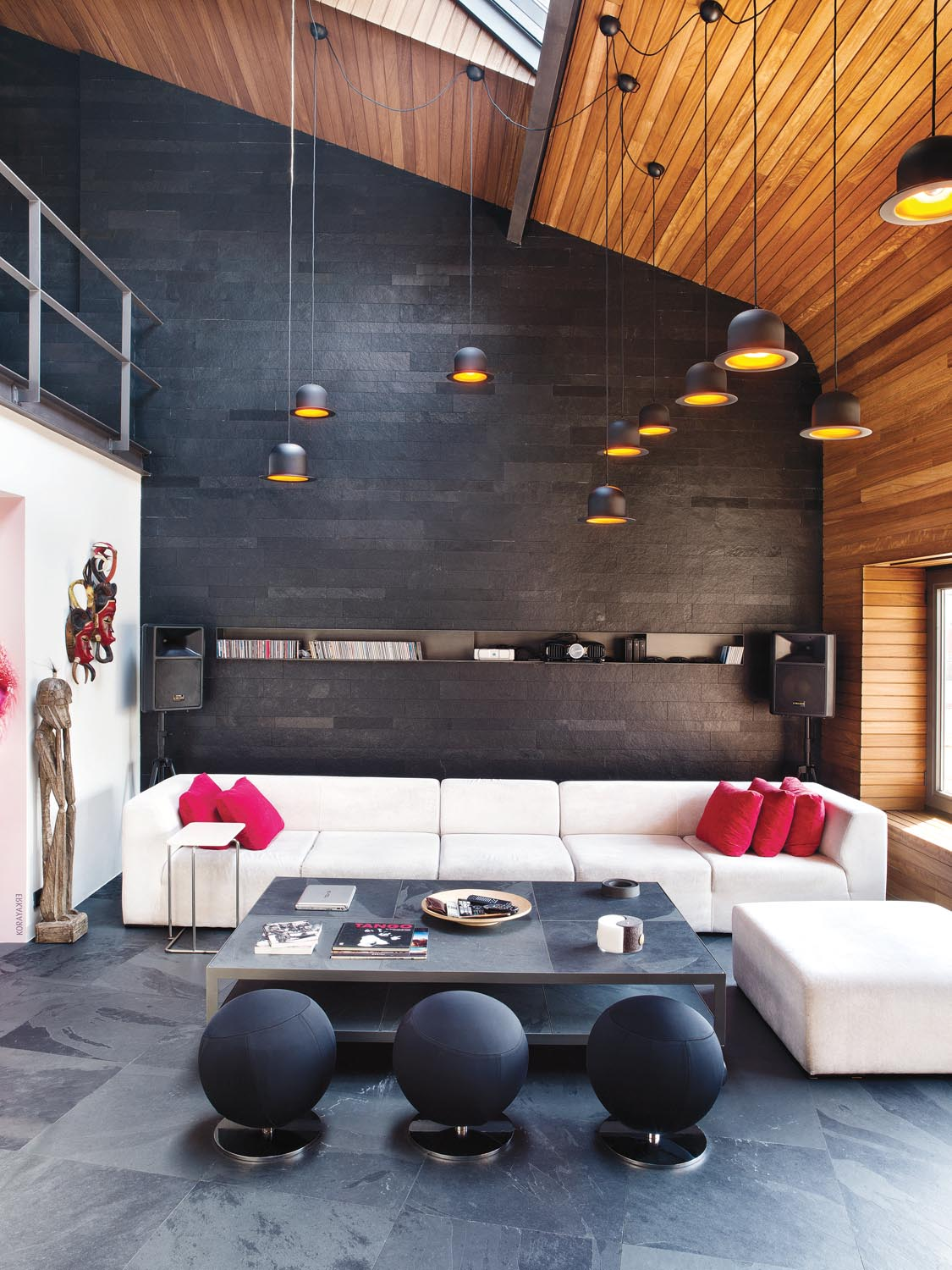 Clusters of lights utilise the high ceilings by hanging at different lengths