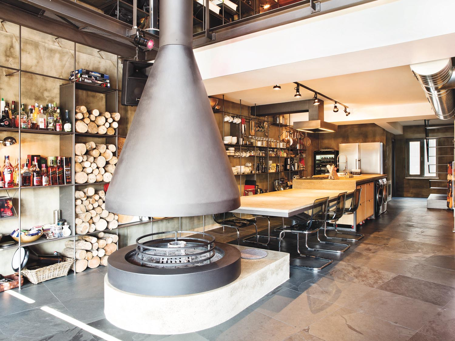 A unique fireplace turns up the heat in the living room and kitchen