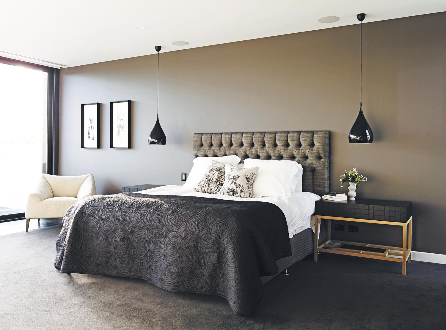 Dark tones create a warm and cosy atmosphere in his plush bedroom