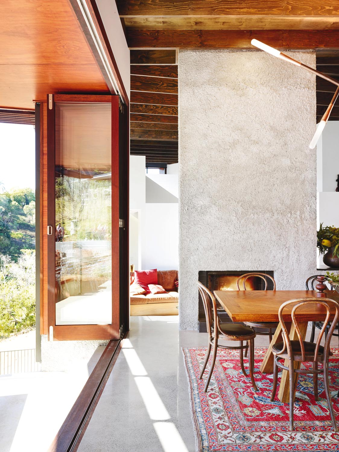 The kitchen opens up on both sides thanks to bi-fold doors
