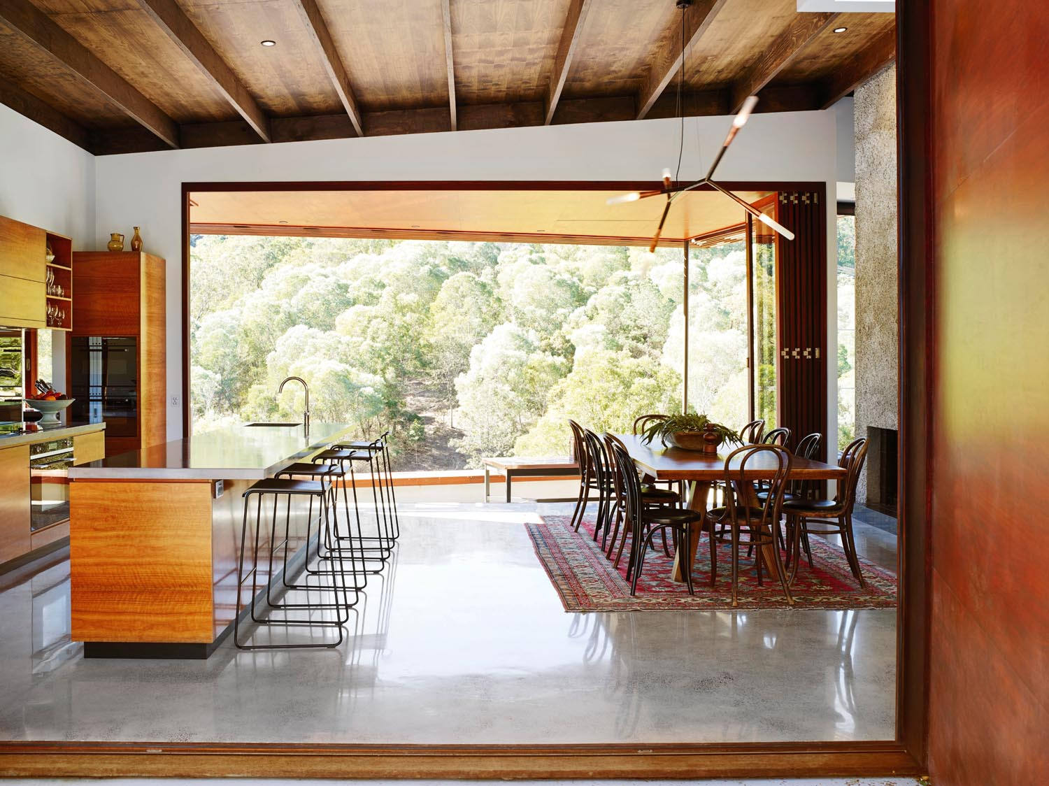 The open-plan kitchen lets in streams of light, meshing the indoors with the outdoors
