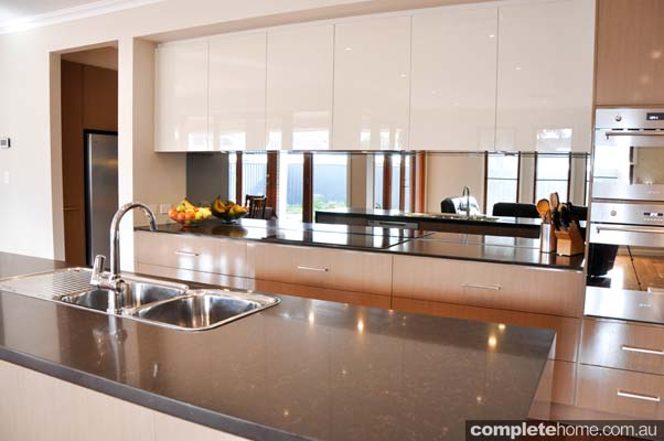 The glamour of gloss streamlined kitchen completehome for Overhead kitchen cupboards