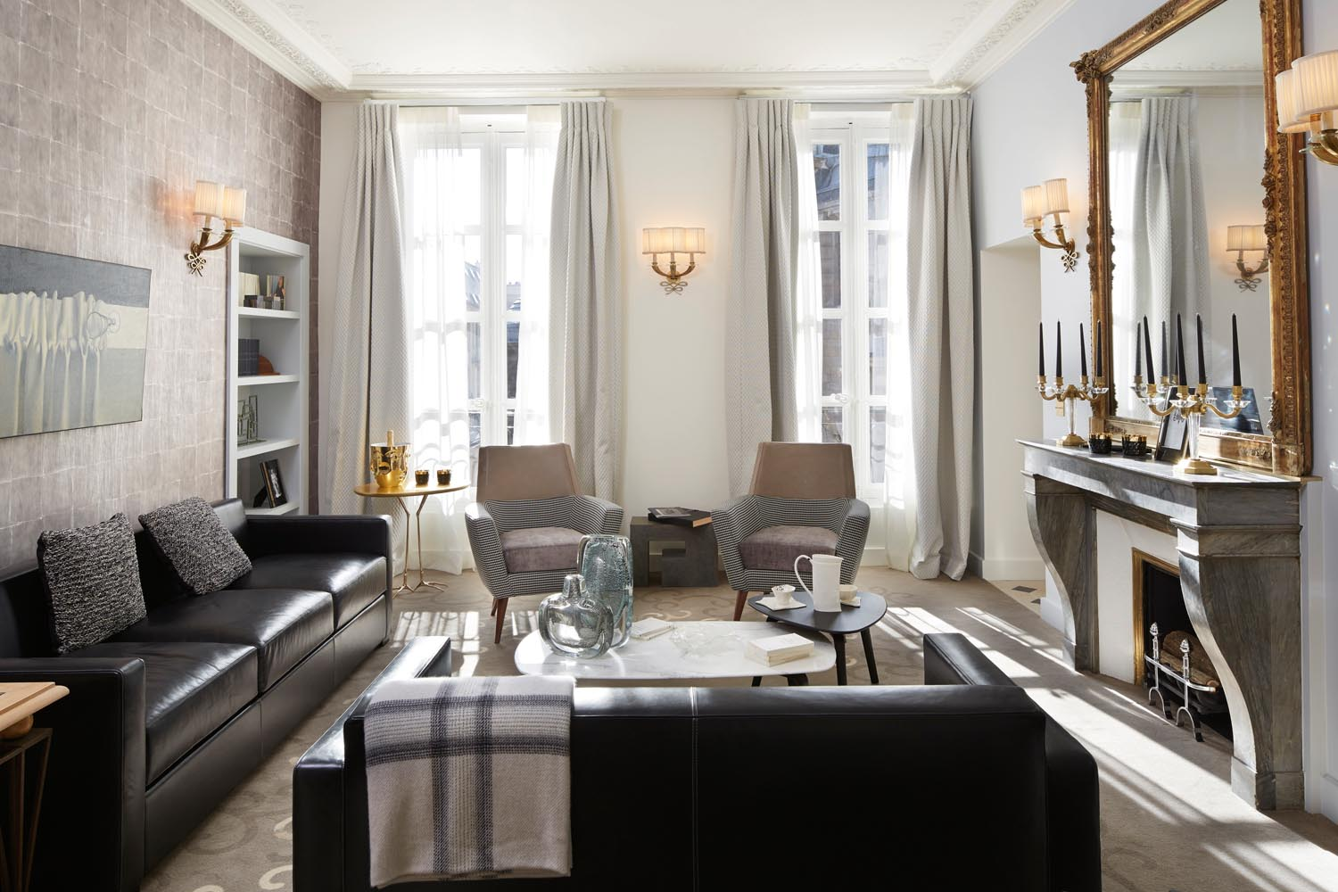 The combination of leather lounges and upholstered chairs ties luxe with contemporary pieces