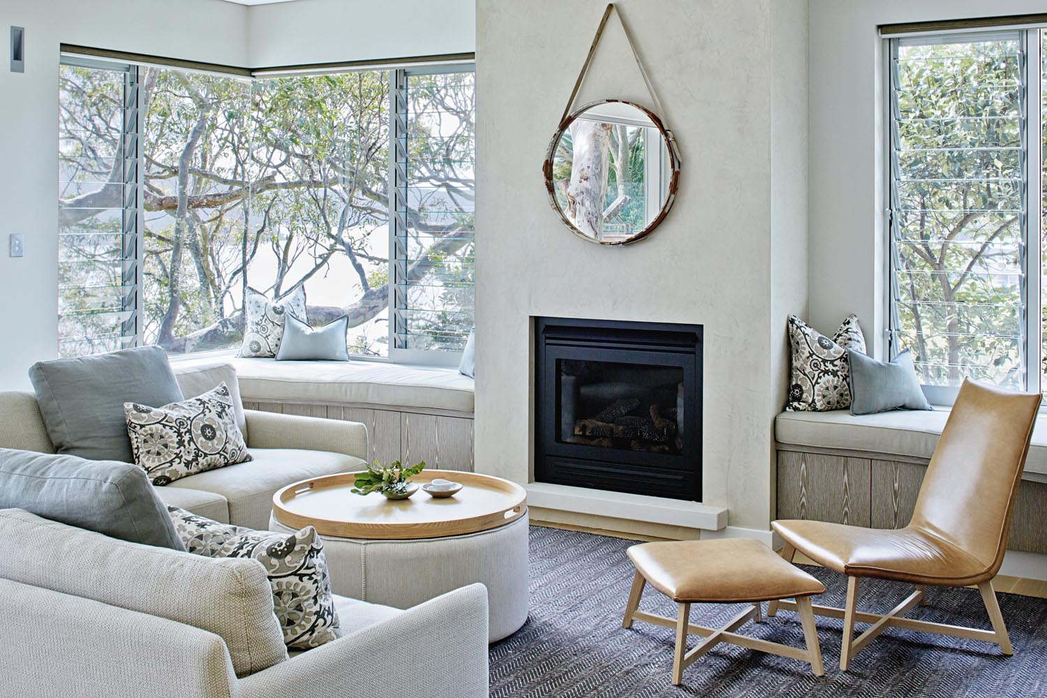 A palette of soft greys and browns adds warmth to the living area