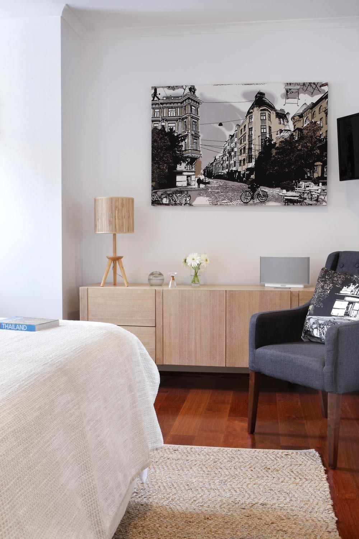 A block-colour armchair breaks up a neutral space