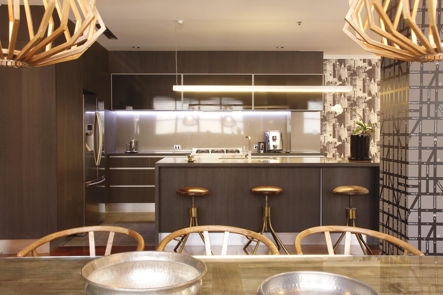 Brass elements add a glamorous and warm feel to the space