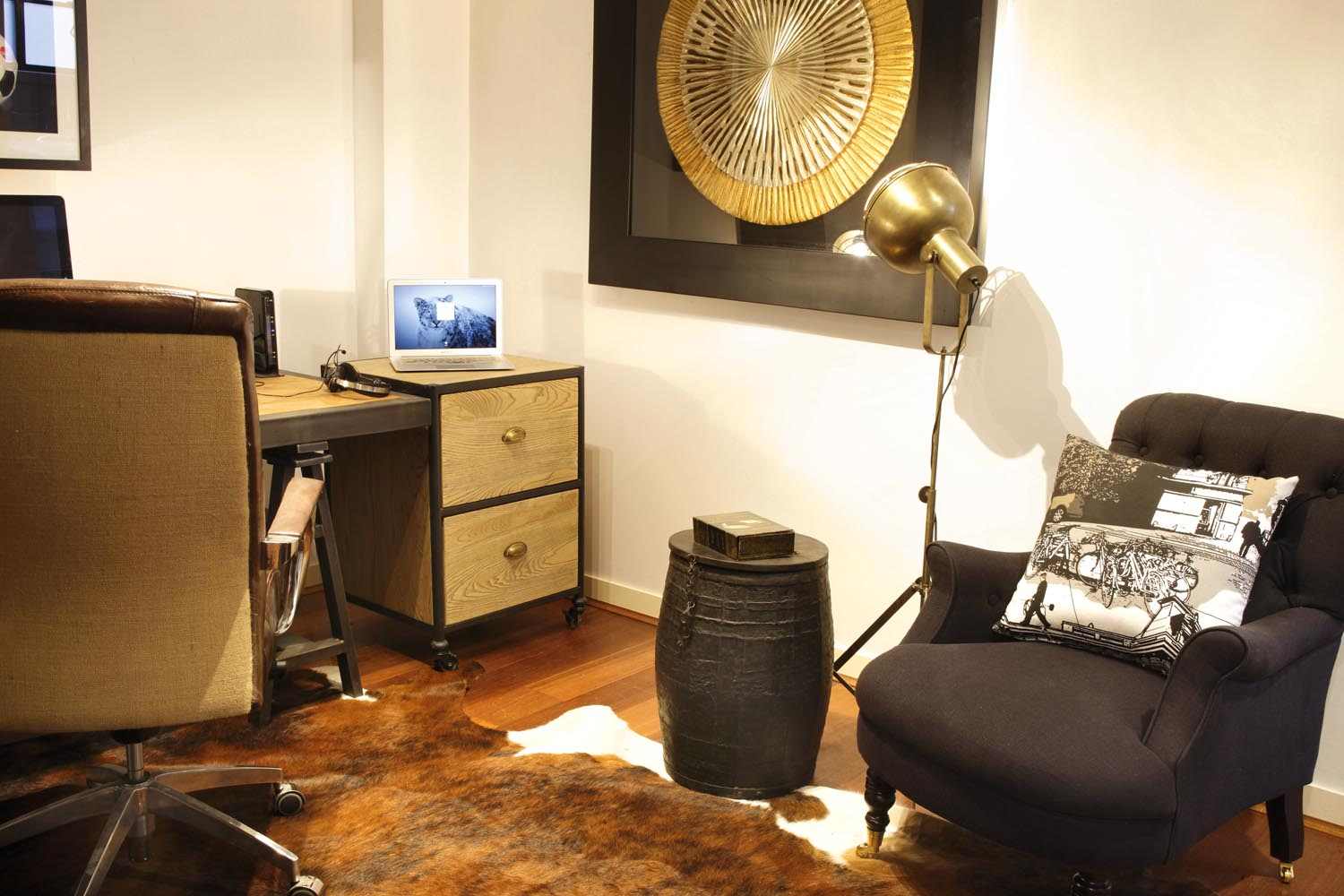 Busy art pieces add interest and liven up a simple room