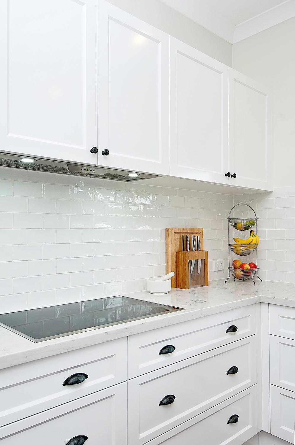 The clean cabinetry in this kitchen creates storage space and a beautiful effect