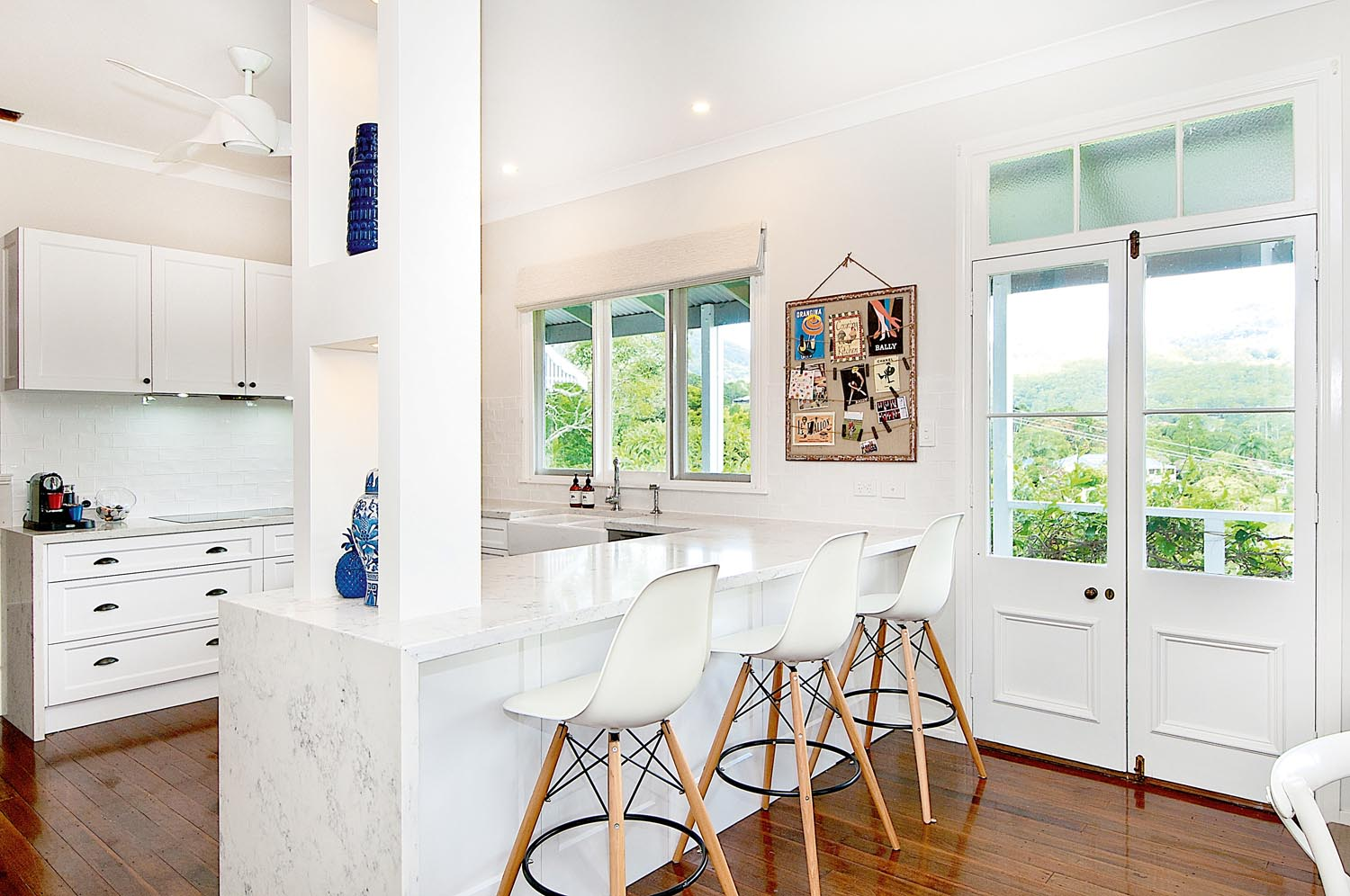 This open white kitchen lets the light in perfectly