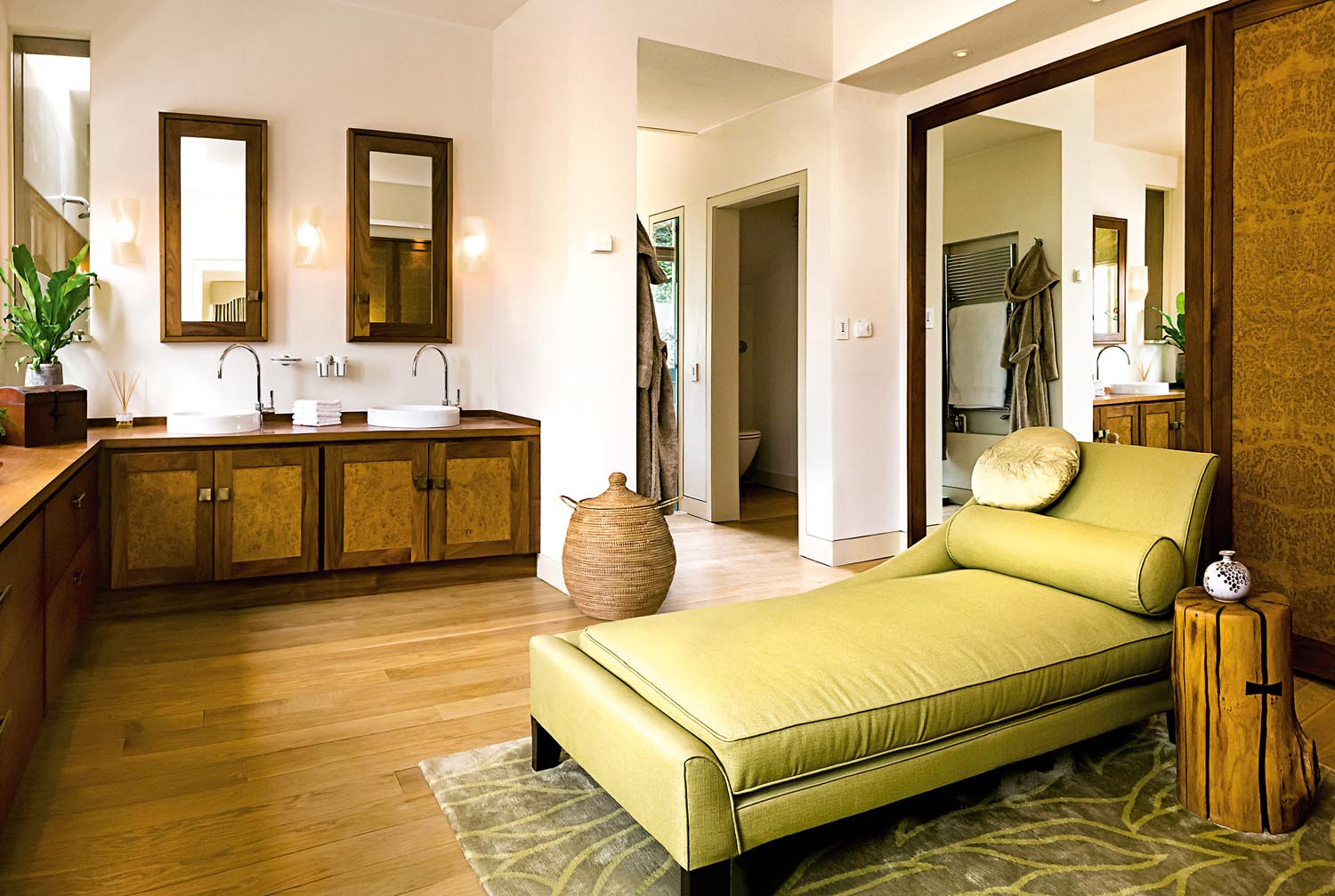 The bathroom serves as a wellness area, with a lounge made for relaxation