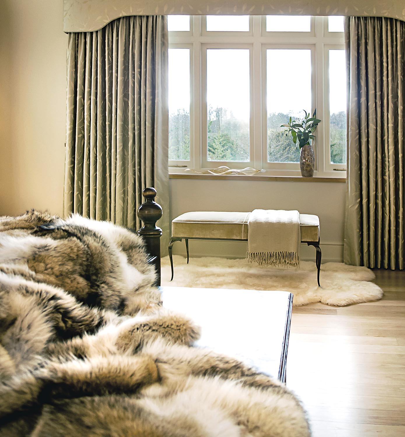 We love: A mix of materials in the master bedroom. Silk and fur adds a luxe element to the space