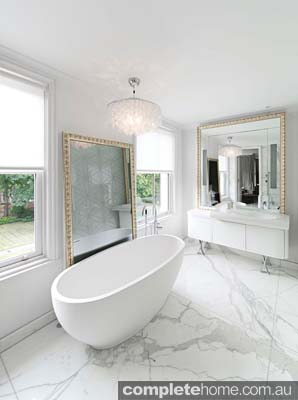 41 - Bath freestanding on bookmatched Calacatta Oro marble floor