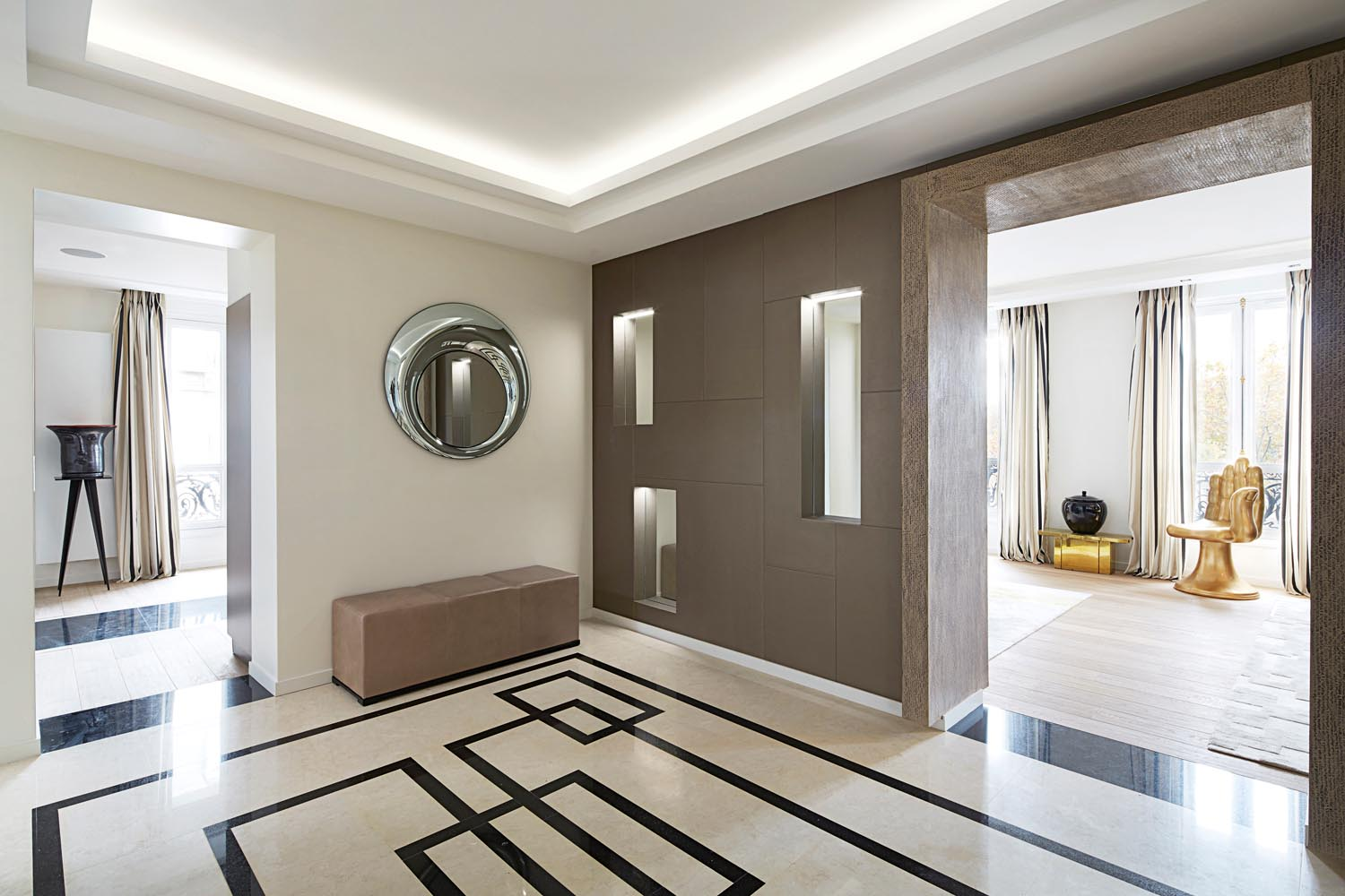 A black and cream marble floor is a luxe addition to the foyer