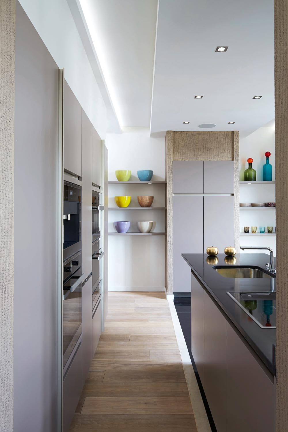 A generous island benchtop provides ample space for cooking