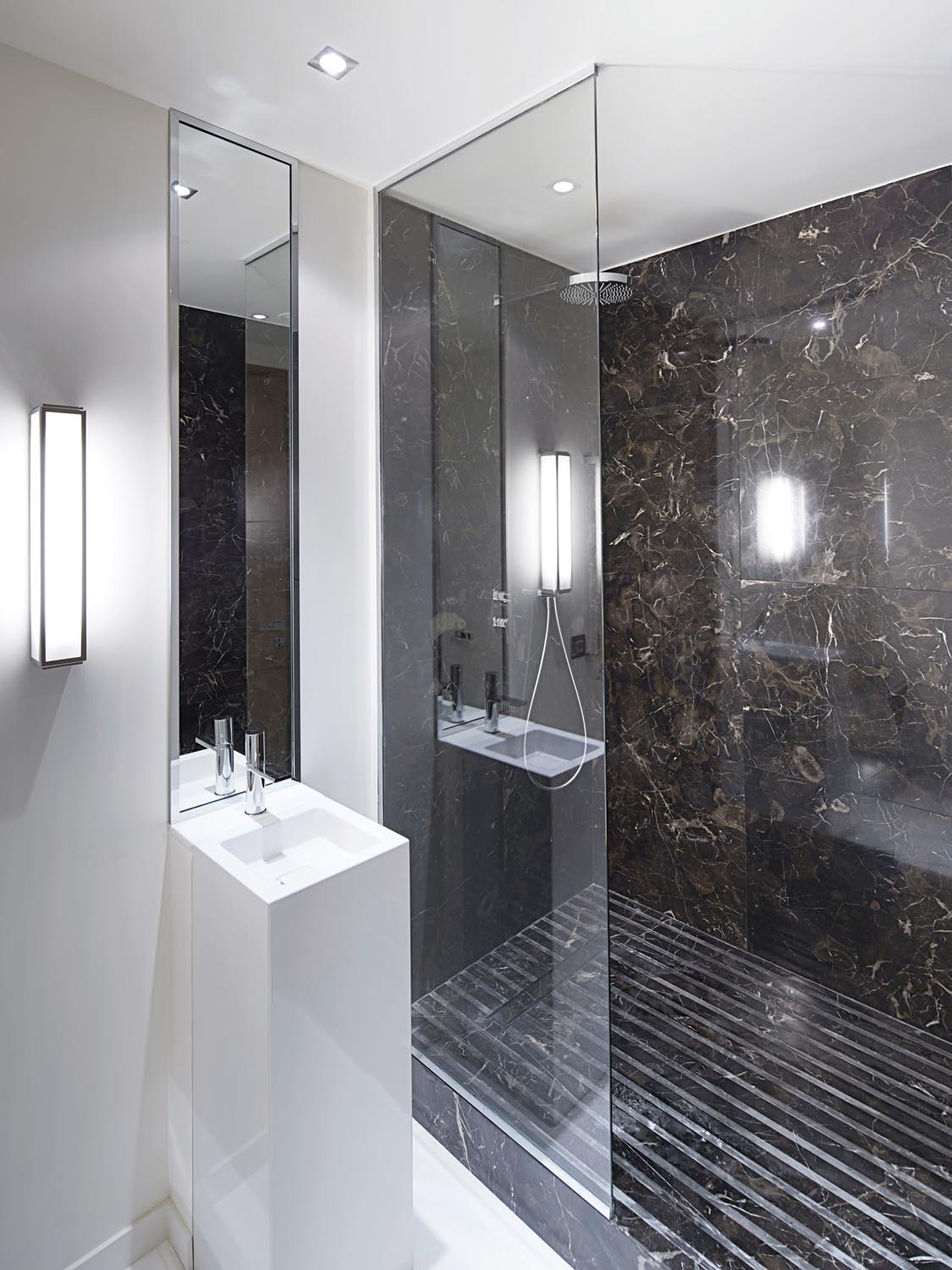 Expert tip: Opting for a smaller basin creates the illusion of space in a guest bathroom