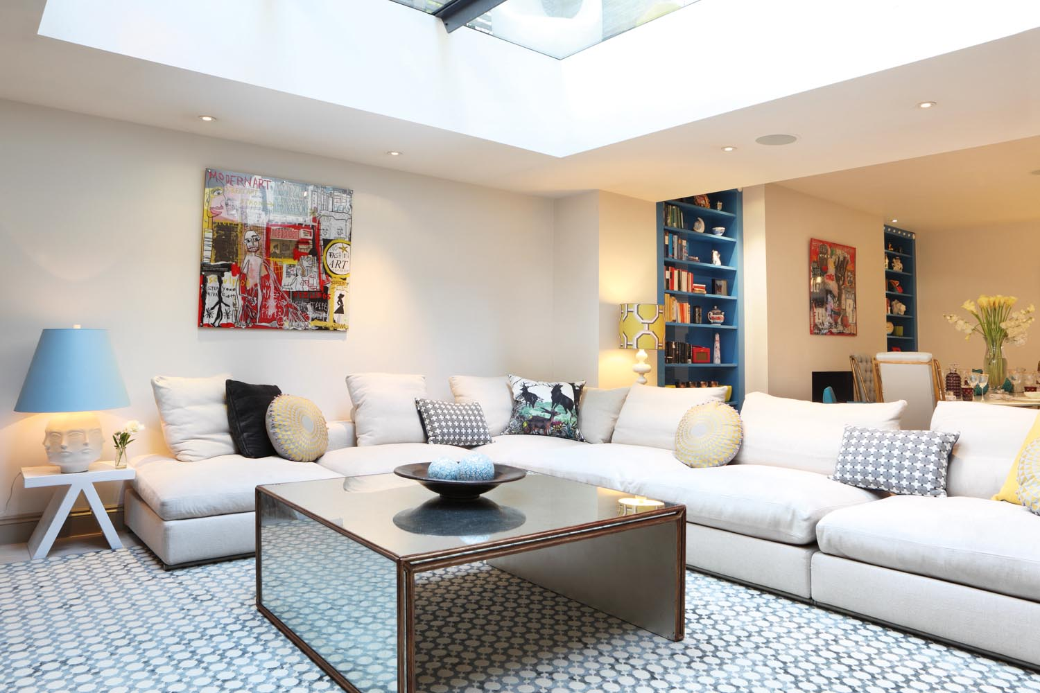 A mirrored coffee table brings a touch of glamour to the living room