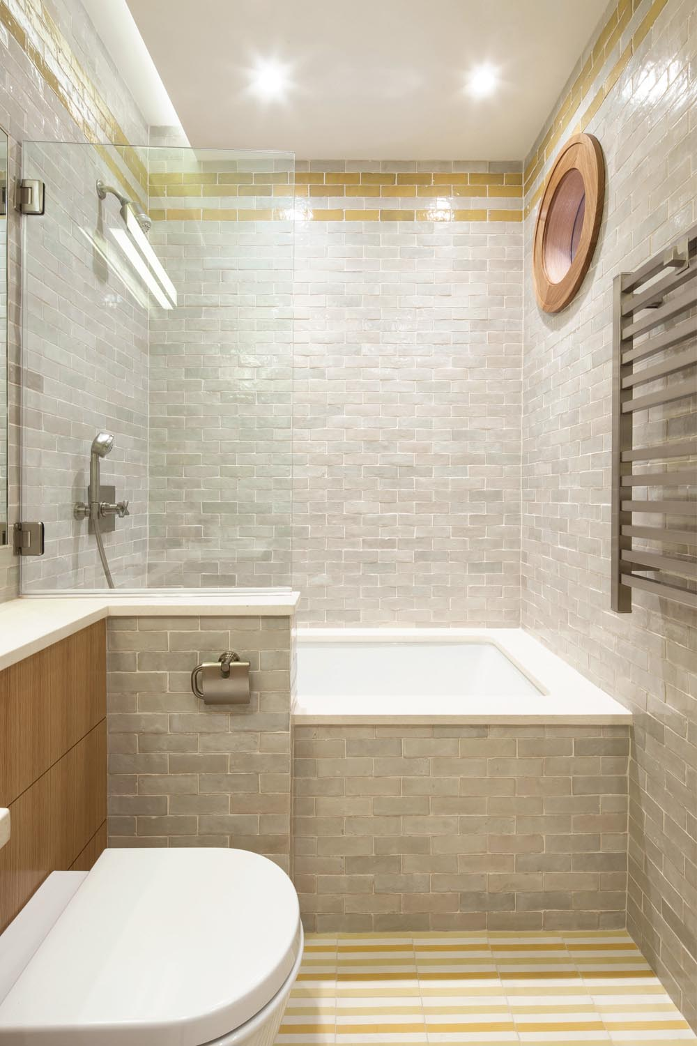 We love: The textured tiles in the bathroom — a great way to introduce interest without colour