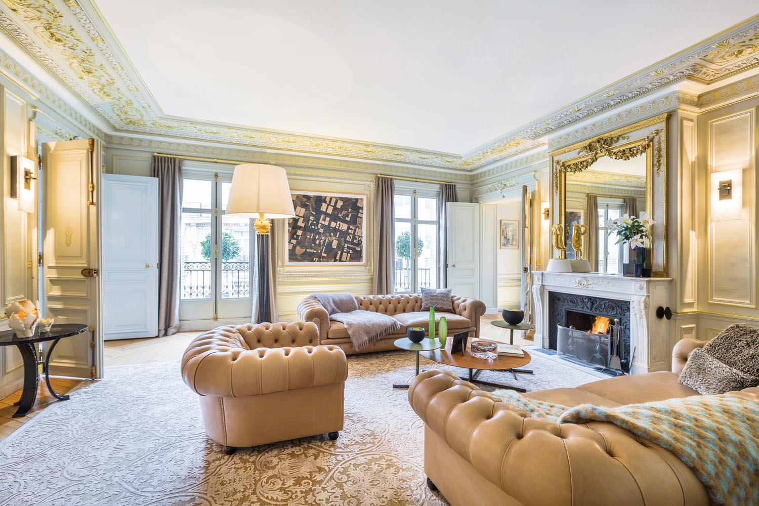 Chesterfield lounges evoke a sense of tradition in a room filled with gold