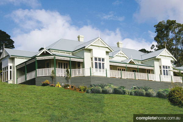A twist on the past colonial era home designs completehome for Victorian style kit homes