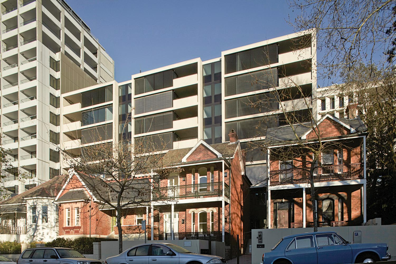 The apartment complex is located behind heritage-listed houses
