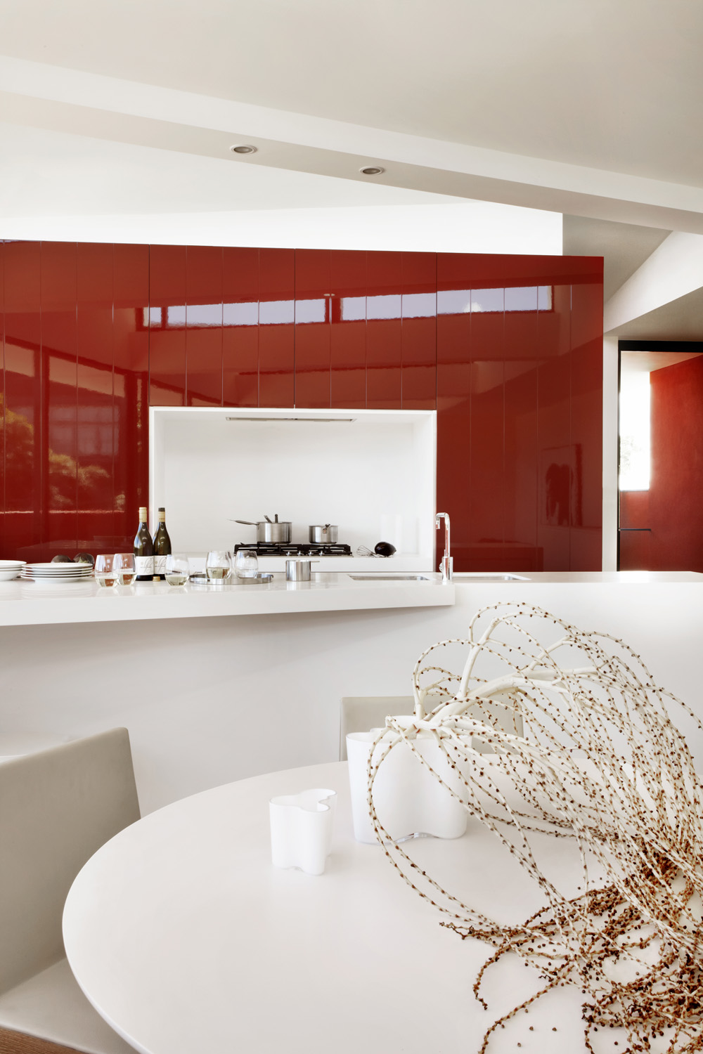 A red splashback is a bold statement that brings heat to the kitchen