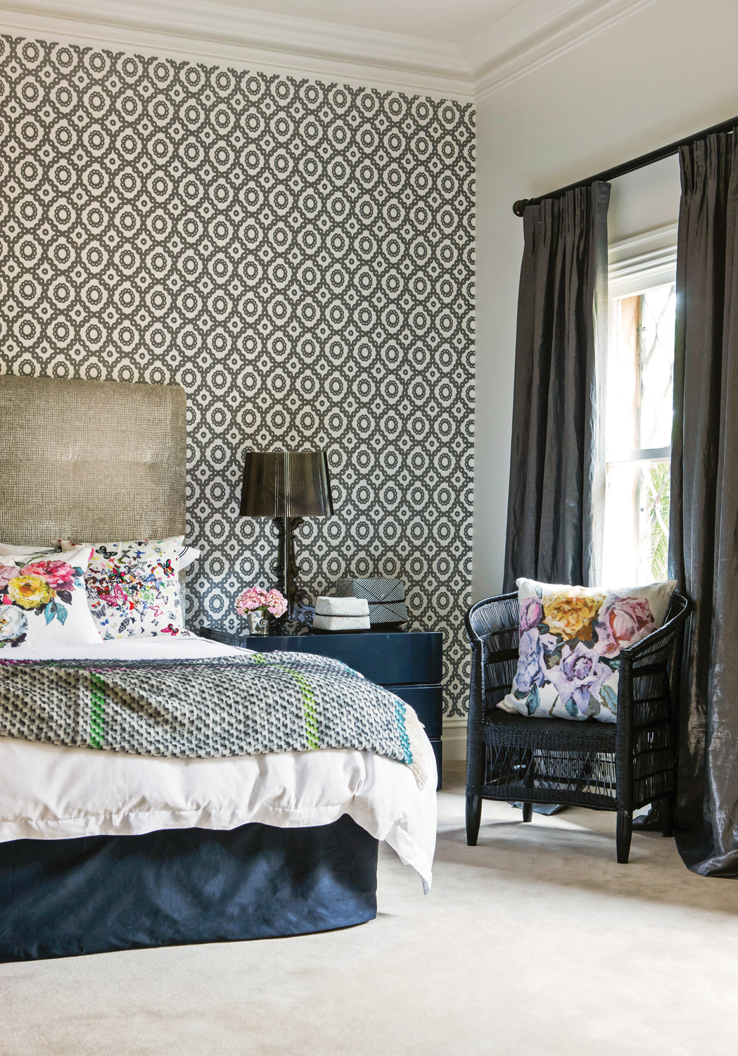 Floral cushions add a touch of femininity to the space