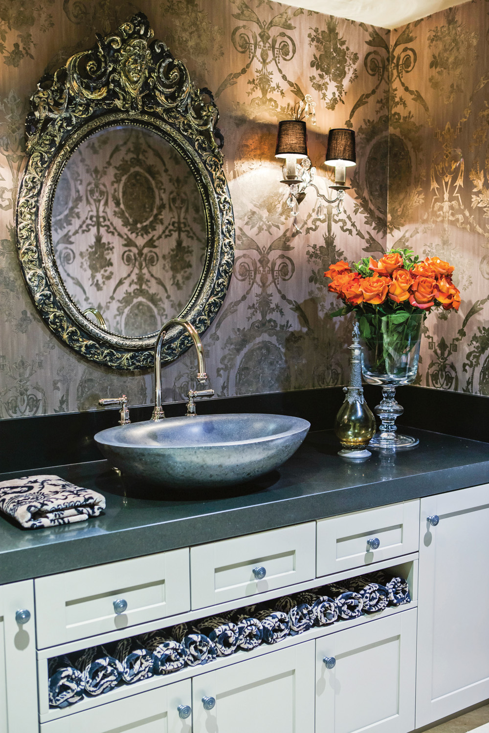 A wallpapered bathroom indicates a luxe affair