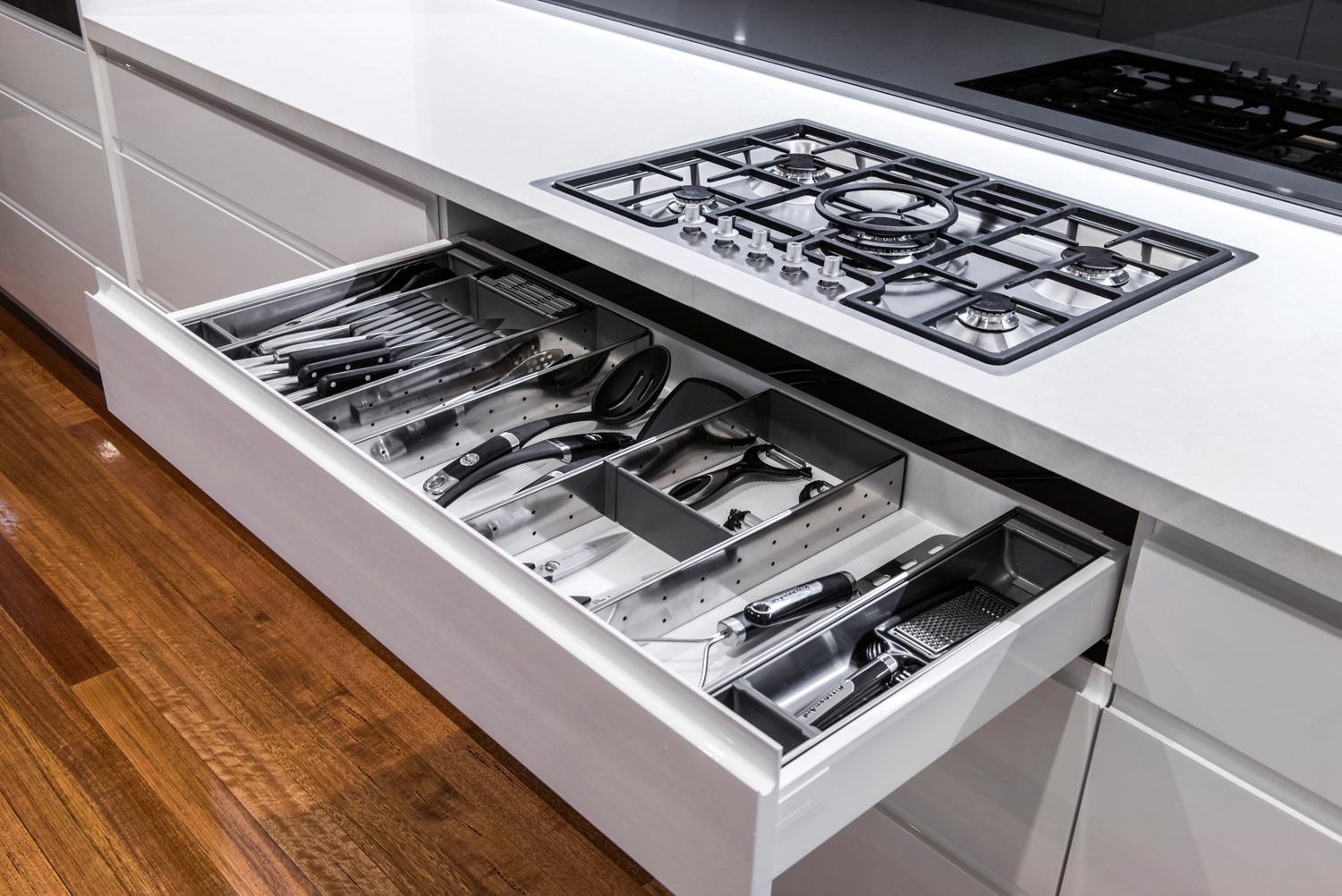Storage has been seamlessly integrated into this kitchen's design