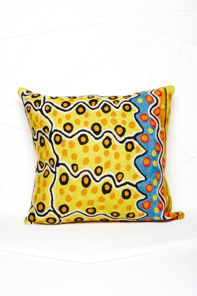 The Better Worlds art cushion by Rama Sampson is chain stitched onto a cotton base using traditional Kashmiri handicraft, while the wool is custom dyed to match the artist's original image. koskela.com.au