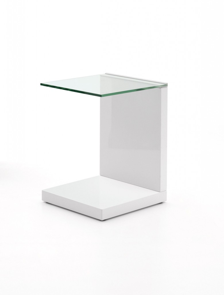 The Hula side table combines monumental design with modernity. The glossy white base and stand works well with the glass cantilevered surface for sculptural appeal. beyondfurniture.com.au