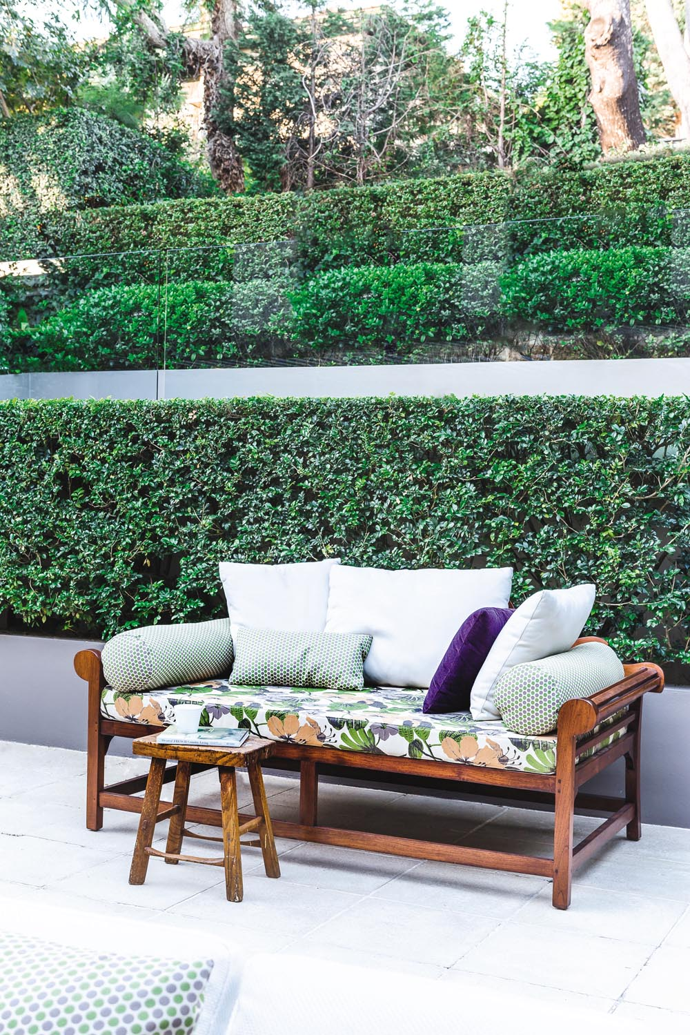 The botanic-inspired fabric on the daybed brings extra life to this area