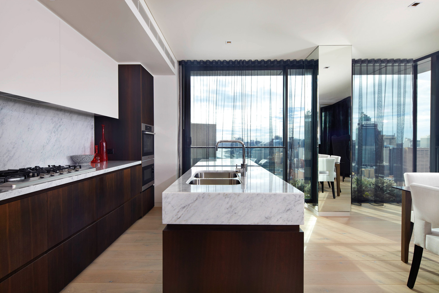 A generous kitchen calls on luxe materials to create a stunning space