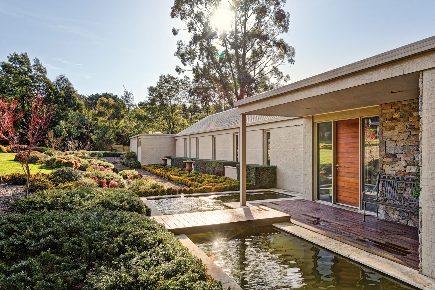 The moat adds an ethereal quality that complements the landscape