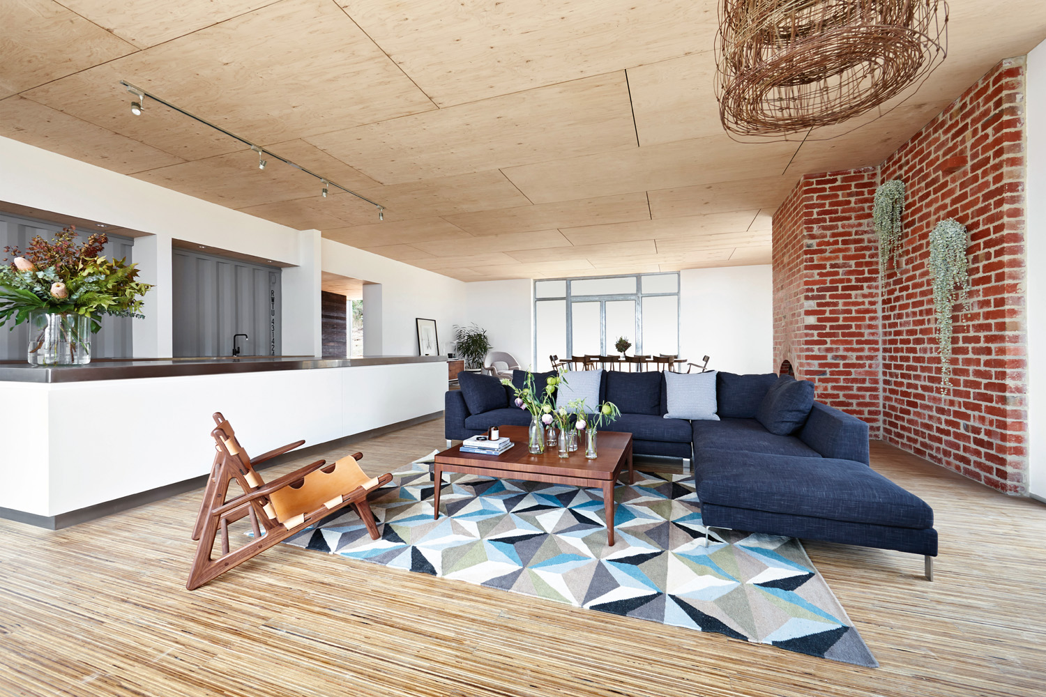 A brick wall provides contrast against the timber interior