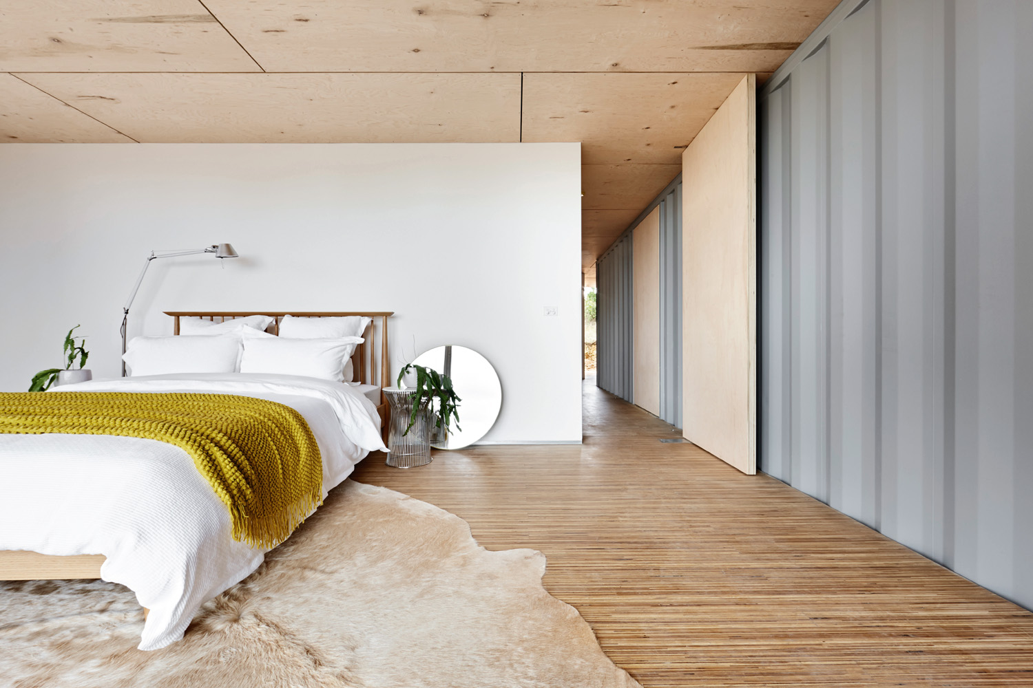 With so much warmth created by the floorboards, simple is best in the bedroom