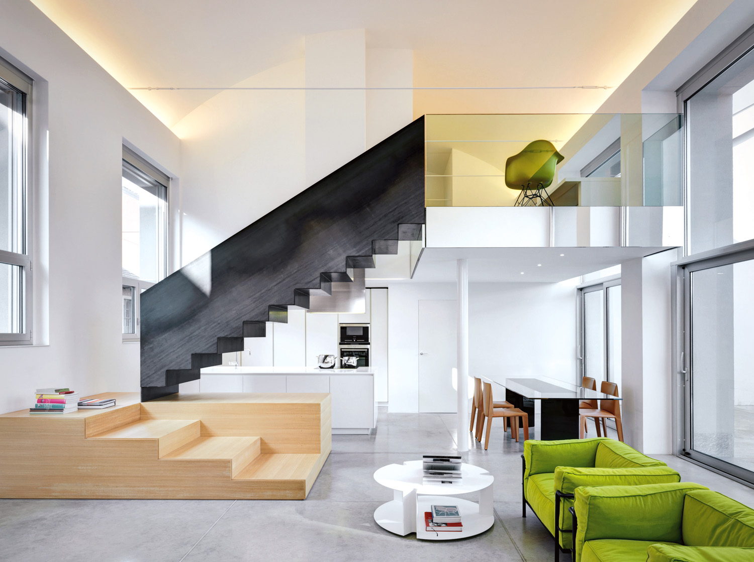 A feature staircase separates the different functions of the open-plan space