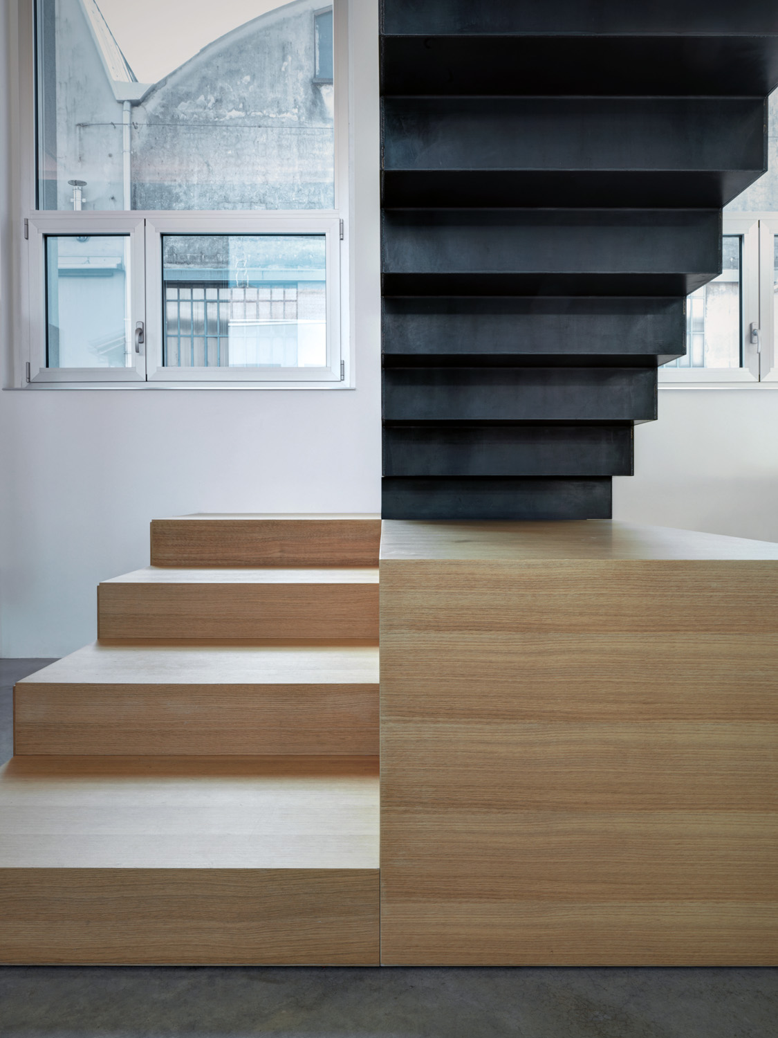 We love: The raw-iron staircase that looks as if it's floating above the living room