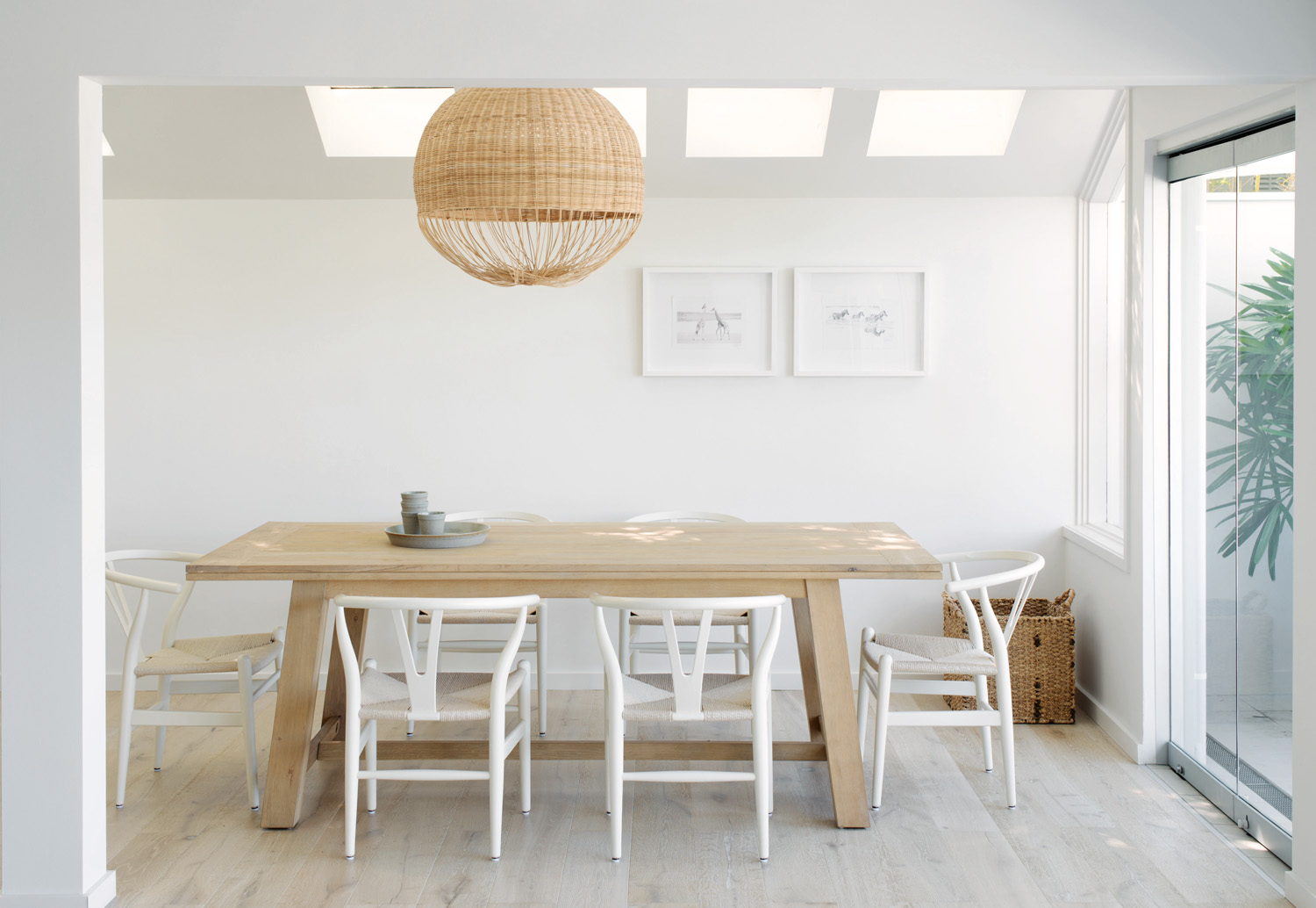 We love: The impressive dining room table surrounded by Wegner's classic Wishbone chairs