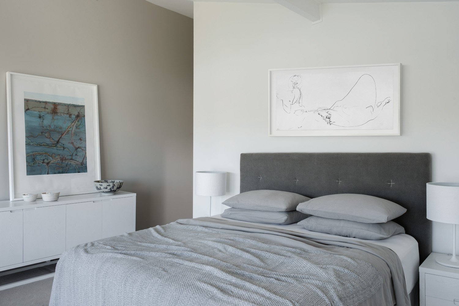 A linen bedhead adds texture to the space