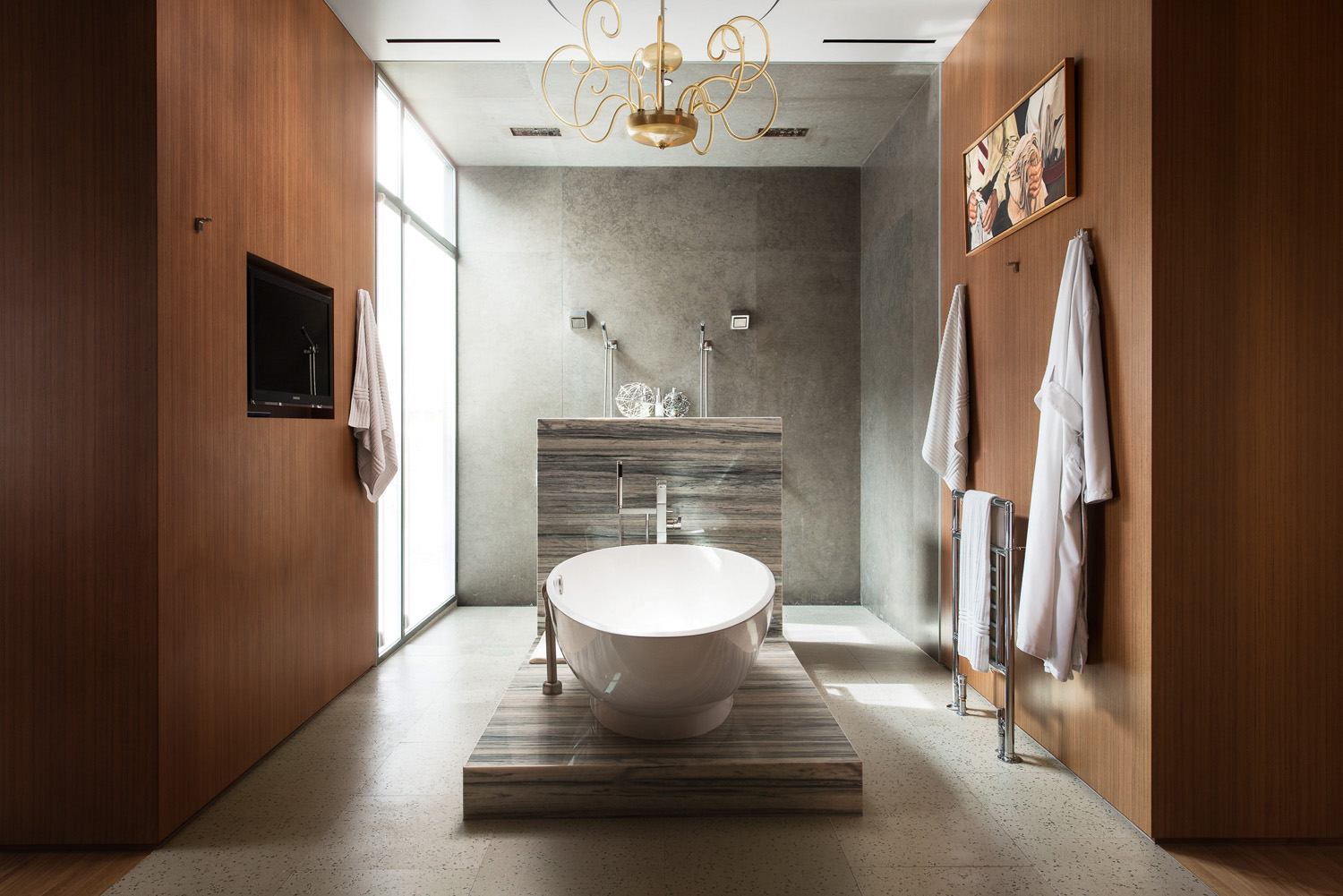 A luxe bathroom features a freestanding tub to soak the day away