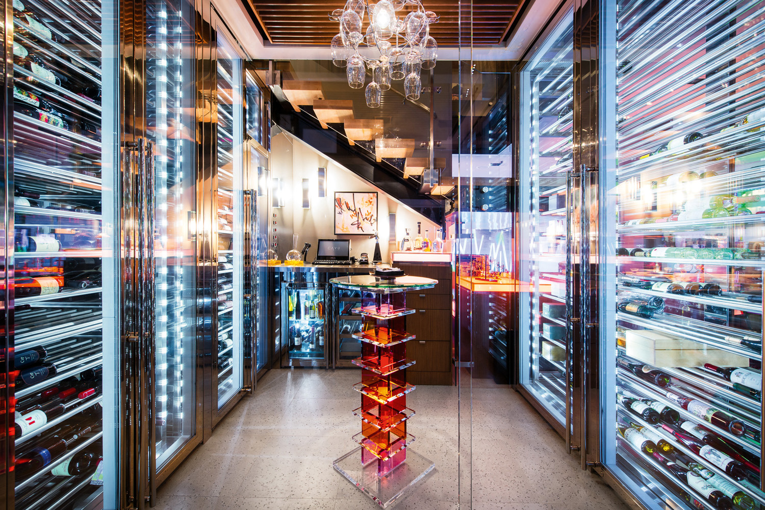 A wine cellar is illuminated to the max with lights