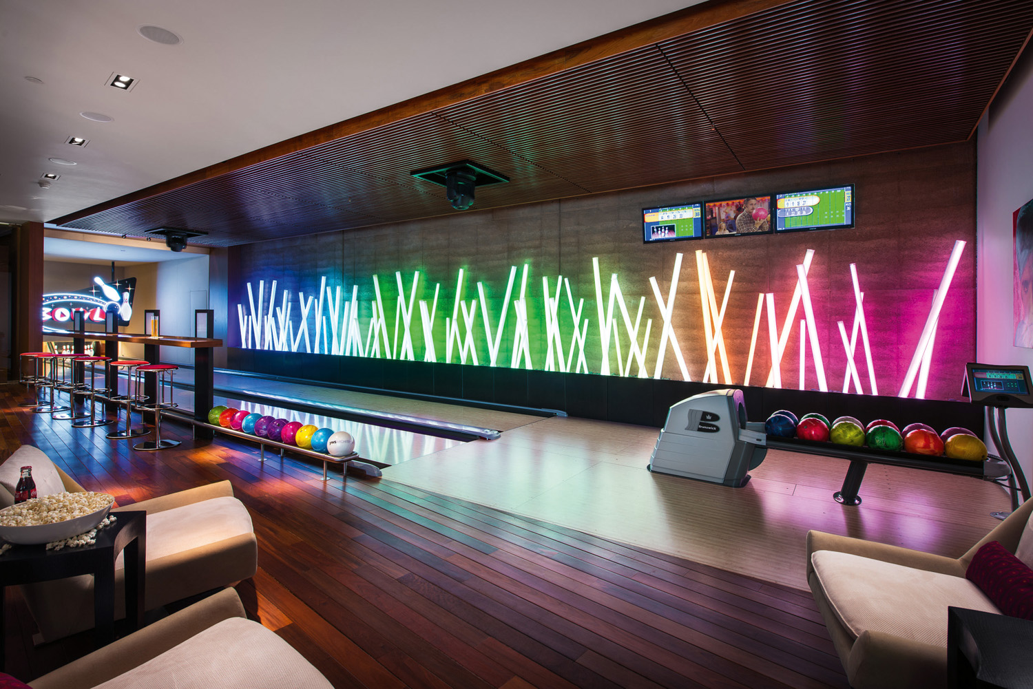 A bowling alley on the play level is decked out with the latest technology