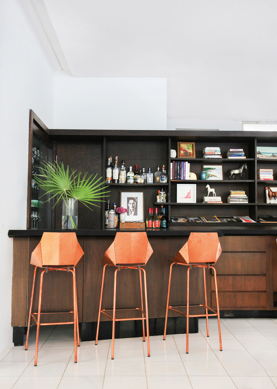Copper stools add glamour to the neutral space